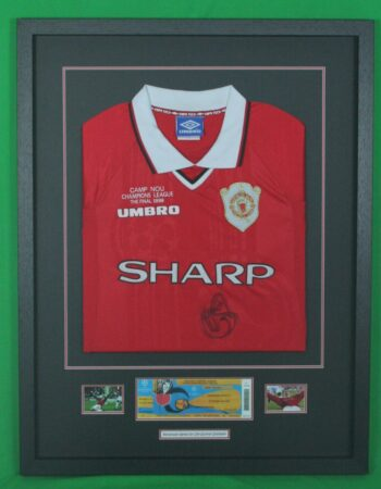 Folded jersey with tickets and photos