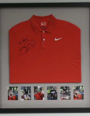 Folded red jersey with photos under